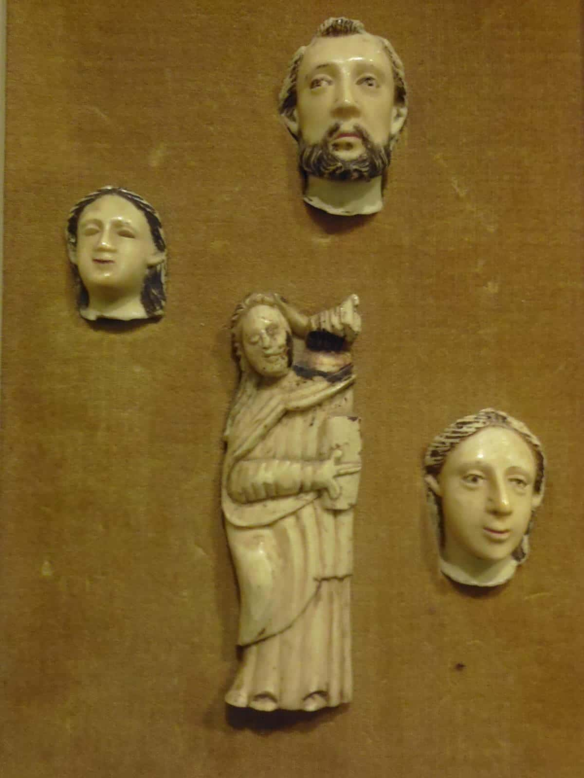 Medieval carved bone reliefs heads